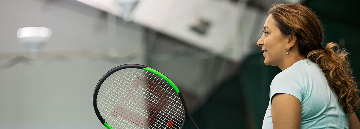 Photo of woman playing tennis.